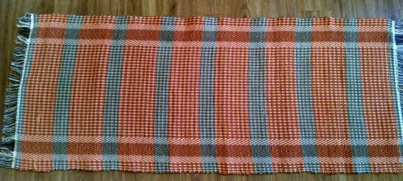 Handwoven rag rug, orange and tan, made in USA