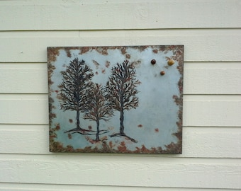 Rusted Magnet Board with an aged and distressed finish, Painted with a trio of rustic trees on sheet metal with nails over a box style frame