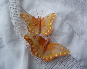 Pastel orange feather butterfly hairclips