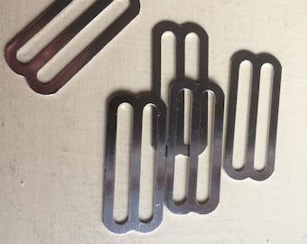 "Metal sliders, suspender sliders, web slides,  1 3/4"" slider, lot of 56"