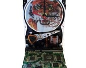 """Hard Drive Clock with Computer Parts """"Tiger"""" Dial and Circuit Board Accented Base."""
