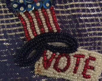 "Beaded sequin ""vote"" pin brooch: timely/no flaws/red white and blue"