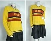 90s Cruel Girl yellow orange blue striped preppy varsity slogan sweater