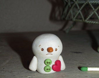 Mini Sad Christmas Snowman holding heart love by Janell Berryman Pumpkinseeds