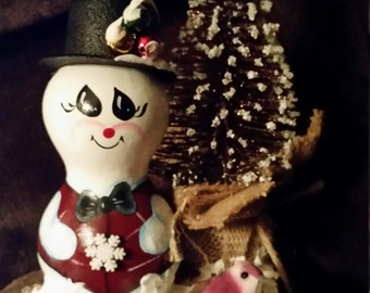 Hand painted tabletop decoration snowman and tree.