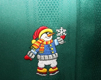 linen napkin with snowman ice skater