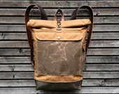 Waxed canvas backpack with roll up top and leather shoulderstraps,handle and leather bottem COLLECTION UNISEX