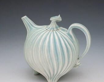 Pastel aqua blue teapot in carved porcelain