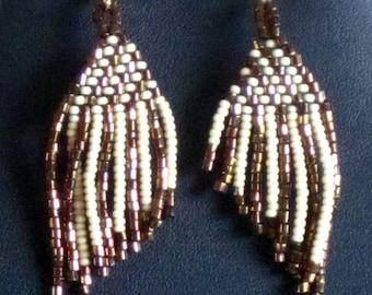 Native American bead weaving earrings in copper and cream