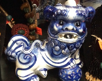 Blue and white Chinese symbolic food dog