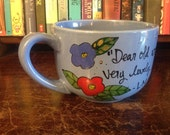 """L.M.M. Montgomery """"Dear old world,"""" Hand painted Anne of Green Gables quote mug - Large, deep blue latte mug with flowers"""