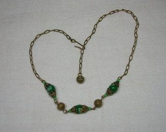 Neiger Necklace, Millefiori Green Czech Glass Beads and Brass. 12 to 14 inches long. Choker Length