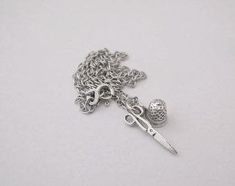 Sterling silver thimble and scissors charm necklace
