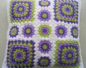Crochet granny square cushion cover in white edging
