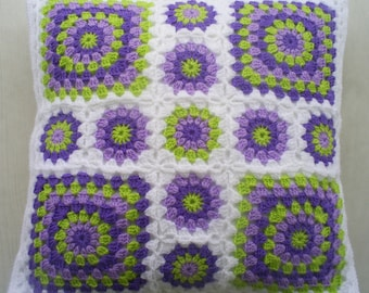 Crochet granny square cushion cover in white edging