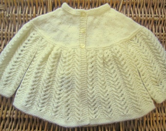 Newborn baby's infant girl or boy traditional handknitted pale yellow handknitted lacy lace matinee jacket cardigan pram outfit set