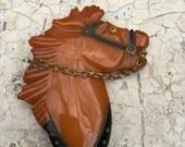 Butterscotch bakelite horse brooch