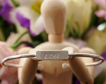 A gorgeous simple hand stamped 'LOVE' bangle, handmade in sterling silver...