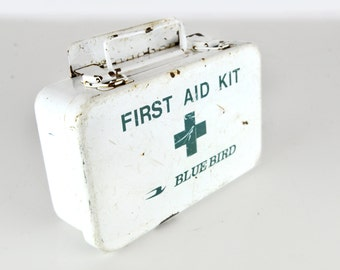 first aid kit, steel, blue bird, white, teal, magnetic, has hanging attachment , storage, keys, remotes, paper, pens, medical supplies