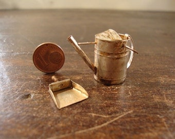 miniature watering can and dustpan very rusty.