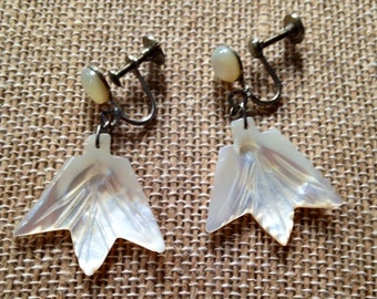 Carved mother of pearl screw back earrings