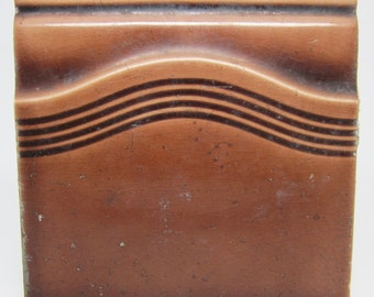 Brown slavaged  tile with wavy pattern