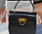 Vintage authentic Salvatore Ferragamo black leather made in Italy great evening purse