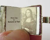 9ct Gold Old Masters Book Charm Opens to famous paintings.