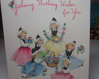 Sweet 1940's-50's Norcross birthday card group of pretty young girls dressed in matching hats and pastel colored dresses,collecting flowers