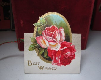 Gorgeous 1920's die cut embossed gold gilded Germany christmas card showing red and white roses