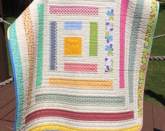 """It's A Scrap Happy Strip Delight In This 39.5"""" X 43.5"""" Quilt"""