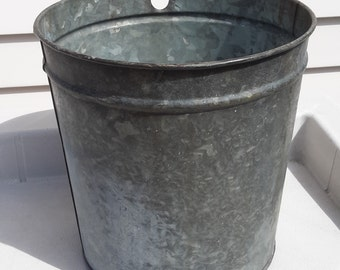 Vintage metal galvanized sap bucket