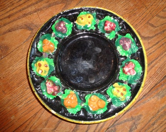 Antique Italian Majolica Pottery Plate with hand painted fruit and floral still life design finish on an ebony background in Good Condition