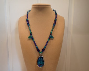 Blue and turquoise necklace with big glass charm