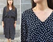 black & white polka dot drop waist pleated dress