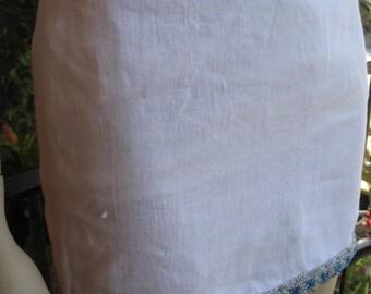 1970s white cotton mini skirt ~ with blue sequin hem