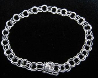 SALE Signed Sterling Silver Double Link Bracelet.  Hidden Pinch Style Box Clasp with Safety Arm.  Stylized M or W Signed in Circle on clasp.