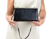 15% OFF VALENTINE SALE Sophisticated vintage clutch handbag of soft Nappa leather from the 70s