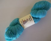 Eman Sock.  100gm  hand-dyed fingering weight yarn.  OOAK- Aqua