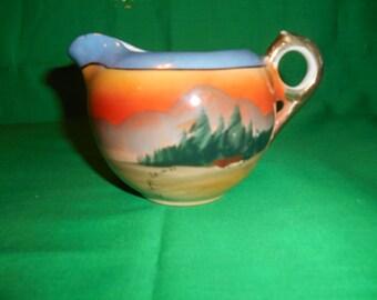 One (1), 6 oz Lusterware, Porcelain Creamer, Marked Made in Japan, Pastoral Scene.