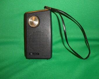 One (1),    Bradford, 7 Transistor AM Radio with Hand Strap.