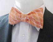 Mens bowtie  - Peach coloured with pink and white grid design  -