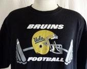 go UCLA Golden Bruins vintage 90's University of California Los Angeles Football NCAA black graphic t-shirt beige back front logo print XL
