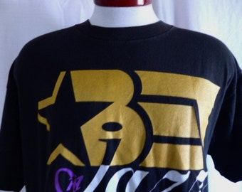 vintage 90s BET on Jazz The Cable Jazz Channel Black Entertainment Network black graphic t-shirt metallic gold white purple logo oversize XL