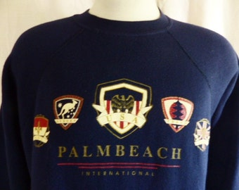 vintage 80's 90's Palm Beach International navy blue fleece graphic sweatshirt crew neck raglan sleeve red white metallic gold logo medium