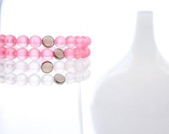 Pink Breast Cancer Survivors and White Support Bracelets