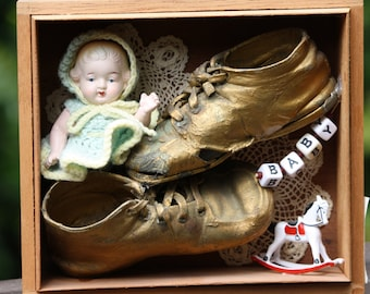 Bronzed baby shoes shadow box