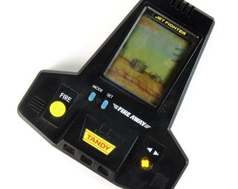 Tandy Fire Away Vintage 1990s Handheld Jet Fighter LCD Game