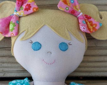 Handmade fabric doll with light brown hair and blue eyes