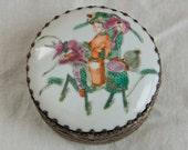 Vintage Asian box…embossed metal trinket box…people riding a dragon.